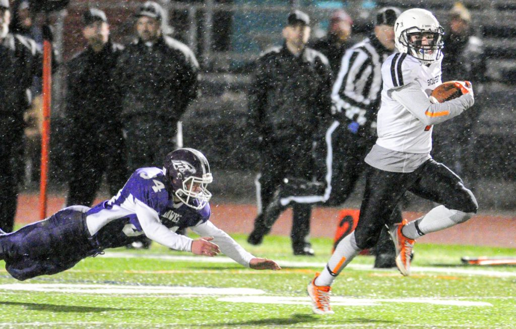 Skowhegan senior Jon Bell out-runs Marshwood defender Colby Leach during a 99-yard kickoff return for a touchdown in the Class B state title game last fall at Fitzpatrick Stadium in Portland.