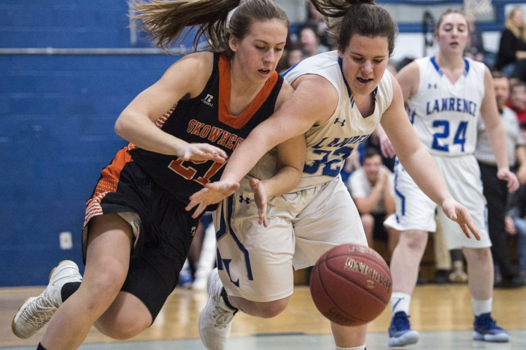 Skowhegan's Annie Cooke, left, battles for the loose ball with Lawrence's Haley Holt in a Class A North game Thursday in Fairfield.