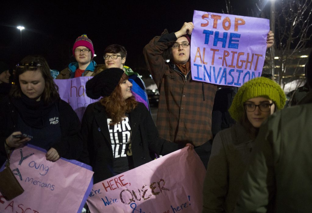 "Demonstrators protest last February outside a University of Southern Maine lecture hall during state Rep. Lawrence Lockman's talk, ""Alien Invasion: Fixing the Immigration Crisis."""