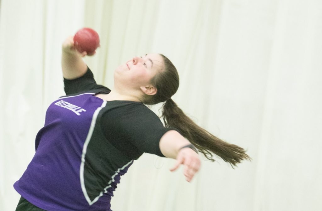 Waterville junior Sarah Cox throwd the shot put during the Kennebec Valley Athletic Conference championship meet Satruday at Bowdoin College. Cox won the event. See story, Page C5.