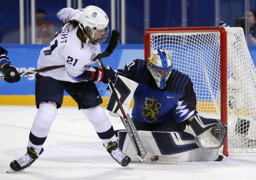 Noora Raty (41), of Finland, blocks a shot by Hilary Knight (21), of the United States, during the second period of the preliminary round of the women's hockey tournament Sunday at the 2018 Winter Olympics in Gangneung, South Korea.
