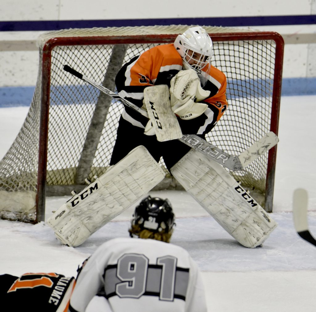 Staff photo by David Leaming   Gardiner goalie Quinn Veregge makes a save during a game Monday against Kennebec at Colby College.