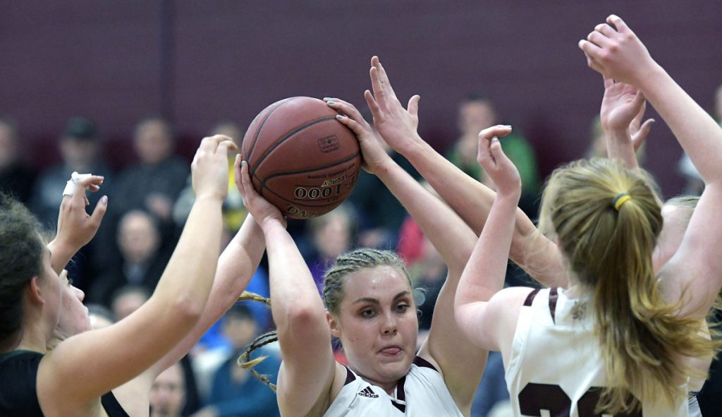 RICHMOND, ME - JANUARY 13: Richmond High School's Sydney Underhill-Tilton goes up for two through Waynfleet's defense during a basketball game on Tuesday February 13, 2018 in Richmond.(Staff photo by Andy Molloy/Staff Photographer)