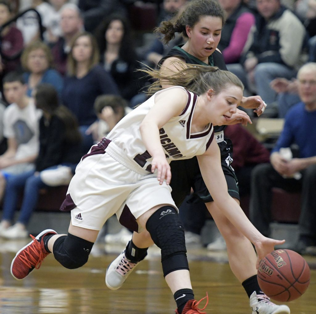 RICHMOND, ME - JANUARY 13: Richmond High School's Ashley Abbott grabs a ball from Waynfleet's Avis Akers during a basketball game on Tuesday February 13, 2018 in Richmond.(Staff photo by Andy Molloy/Staff Photographer)