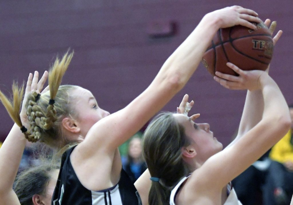 RICHMOND, ME - JANUARY 13: Richmond High School's Lindsie Irish is blocked by Waynfleet's Lydia Giguere during a basketball game on Tuesday February 13, 2018 in Richmond.(Staff photo by Andy Molloy/Staff Photographer)