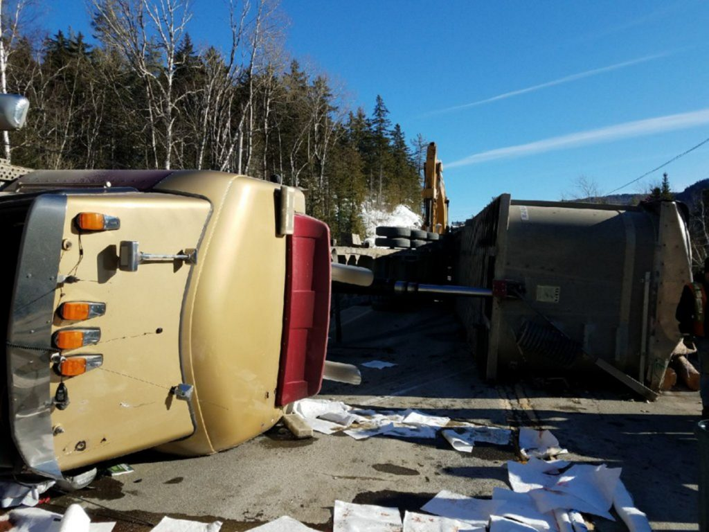 A logging truck overturned Tuesday afternoon on Route 27 in Chain of Ponds Township. Driver Timmy Philippon, 22, of Quebec, was injured, Maine State Police Trooper Jillian Monahan said.