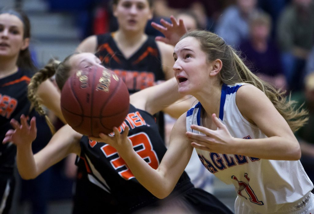 Photo by Ashley L. Conti   Messalonskee's Brianne Benecke, right, is fouled by Gardiner's Bailey Poore during the first half of their Class A North game last month in Oakland. Both teams will play in the tournament beginning today.
