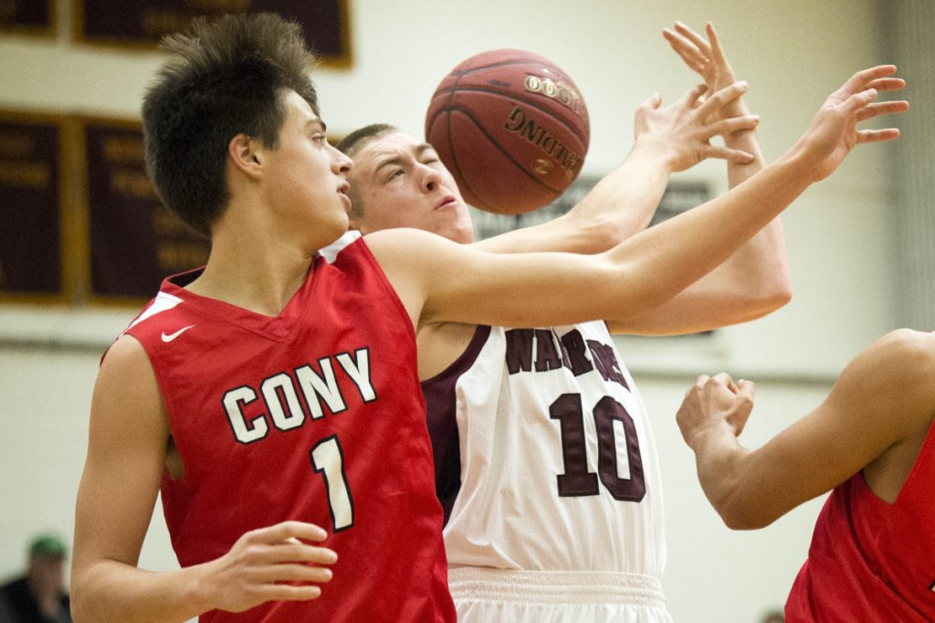 Nokomis' Brock Graves (10) battles for a rebound with Cony's Ian Bowers (1) during a Class A North game earlier this season in Newport.