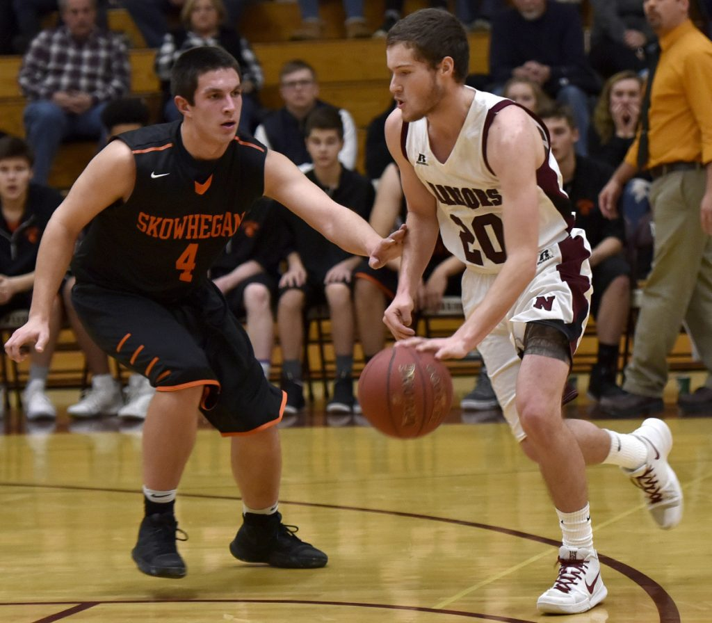 Nokomis senior guard Zach Hartsgrove dribbles past Skowhegan defender Marcus Christopher during a Kennebec Valley Athletic Conference Class A game earlier this season in Newport.