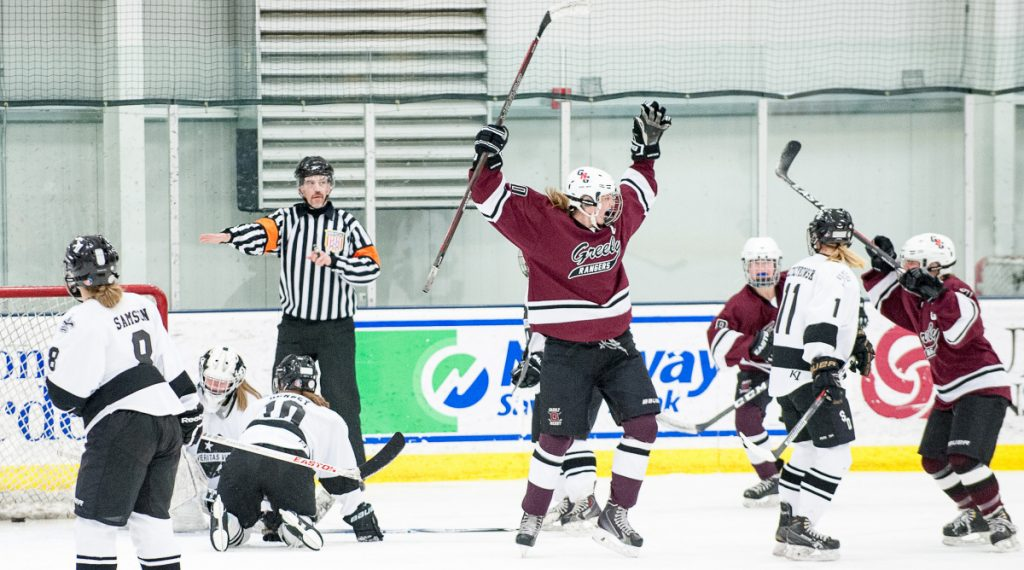 Greely's Courtney Sullivan, center, celebrates a goal during a playoff game at the Norway Savings Bank Arena in Auburn.