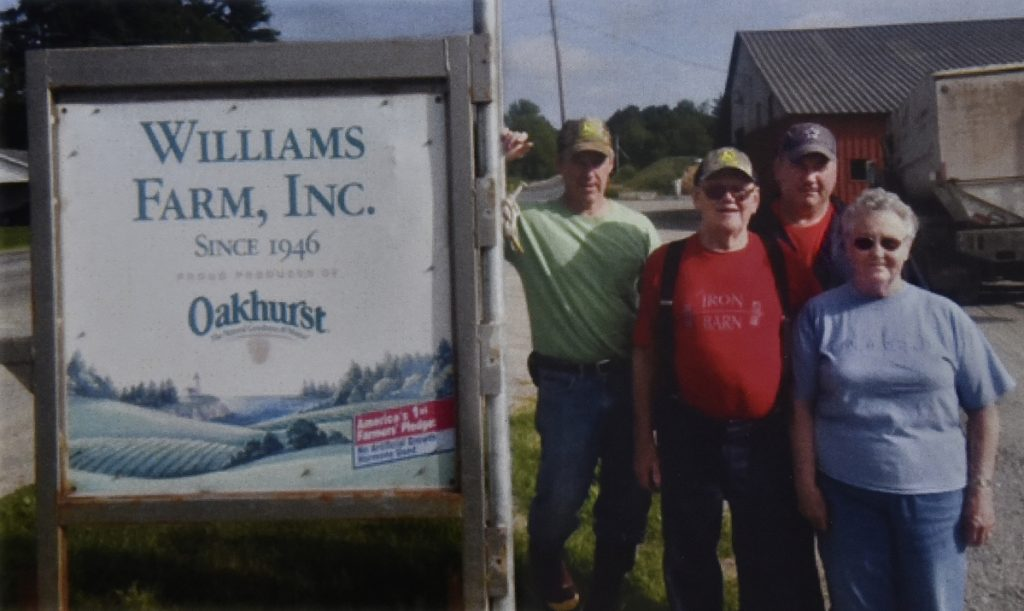 The Williams Farm in North Anson is being recognized by the town of Anson in the annual report for this year's Town meeting. Standing in the rear are current owners Richard Williams, left, and brother Andy. Their parents, Harvey and Jean Williams, are in the foreground.