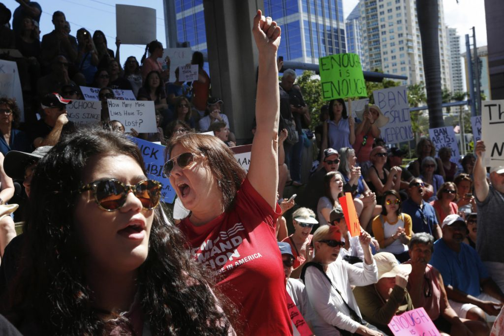 Helena Moreno, center, yells during a protest against guns on the steps of the Broward County Federal courthouse in Fort Lauderdale, Fla., on Feb 17. Nikolas Cruz, a former student, is charged with killing 17 people at Marjory Stoneman Douglas High School in Parkland, Fla., on Wednesday.