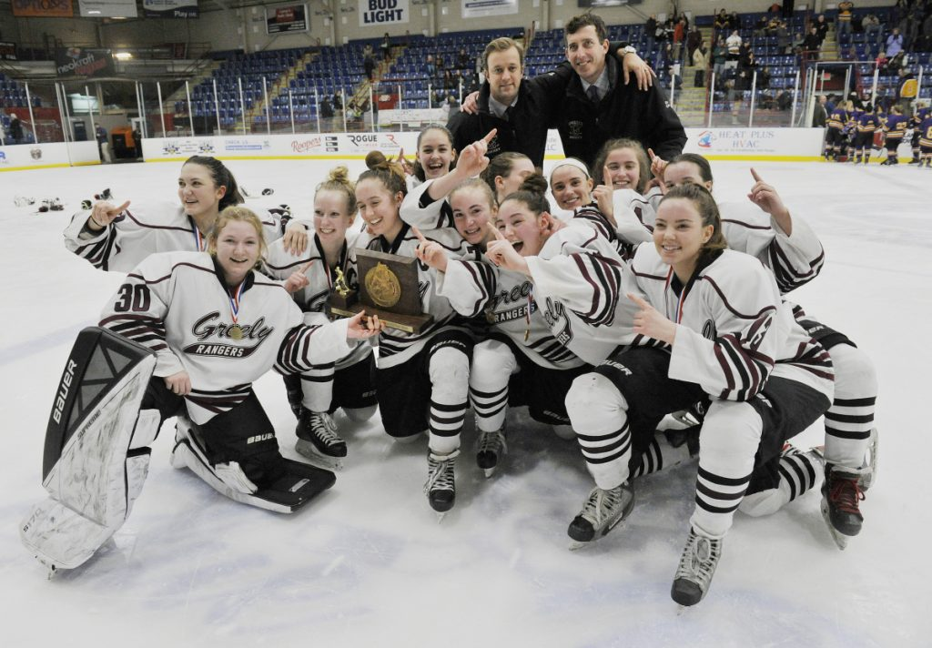 Members of the Greely/Gray-New Gloucester girls hockey team celebrate after they won the girls hockey state championship Saturday in Lewiston.