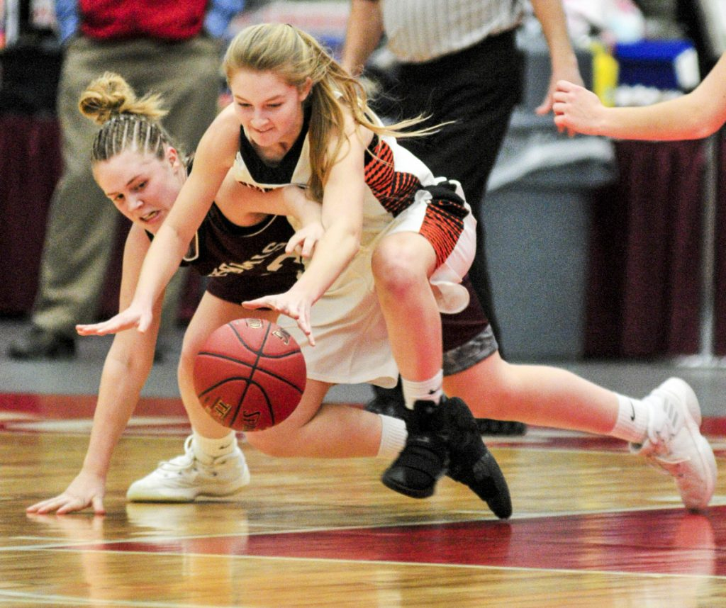 Staff photo by Joe Phelan   Nokomis' Maci Leali, left, and Skowhegan's Mariah Dunbar battle for a loose ball during a Class A North quarterfinal game Friday  at the Augusta Civic Center.