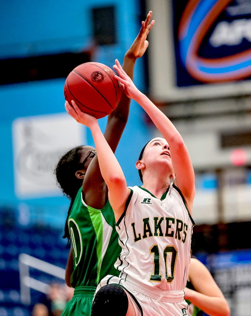 Rangeley's Brooke Egan eyes the basket as Pine Tree Academy's Regence Sandy defends during a Class D South quarterfinal game Monday at the Augusta Civic Center.