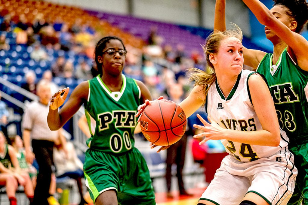 Rangeley's Natasha Haley looks for some space as Pine Tree Academy's Agnes Miongo, right, and Regence Sandy defend during a Class D South quarterfinal game Monday at the Augusta Civic Center.