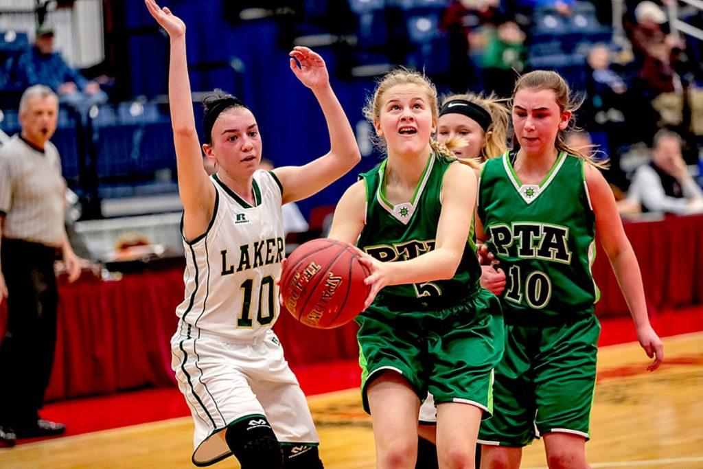 Pine Tree Academy's Emily Schlisner goes to the basket as Rangeley's Brooke Egan looks to defend during a Class D South quarterfinal game Monday at the Augusta Civic Center.