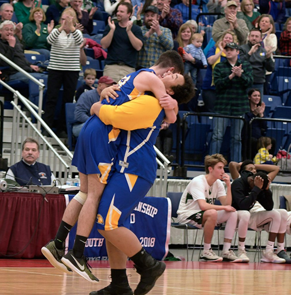 Boothbay players celebrate after they stunned Waynflete 65-64 in a Class C South quarterfinal game Monday at the Augusta Civic Center.