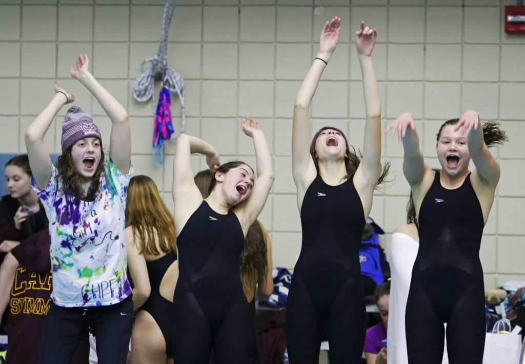 Cape Elizabeth teammates Olivia Tighe, Maddie McCormick, Corinne Wight and Hope Campbell get excited early in the Class B State swimming and diving championships Monday at Bowdoin College.