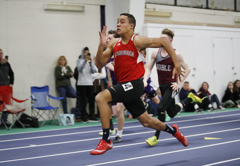 Jared Flaker of Scarborough runs in the 55-meter dash to set a new state record during the Maine Class A track and field championships on Monday in Gorham.