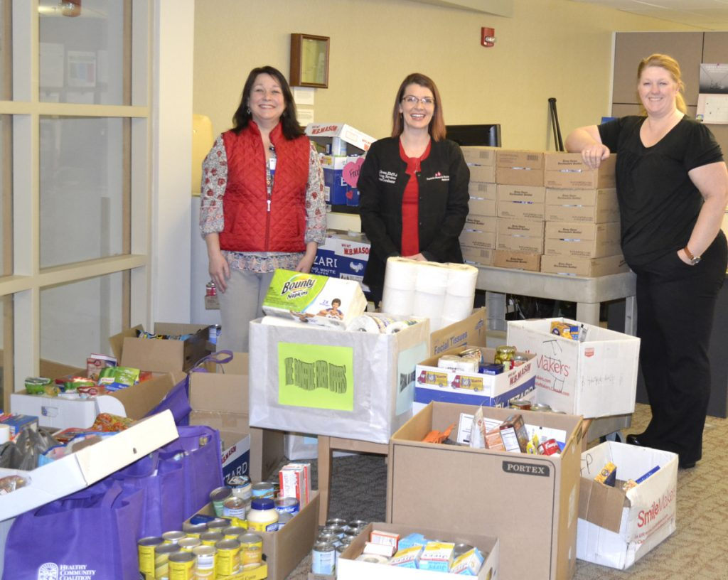Great Food Drive helpers, from left, are Rebecca Wood, M. Breau and Kristen Grondin.
