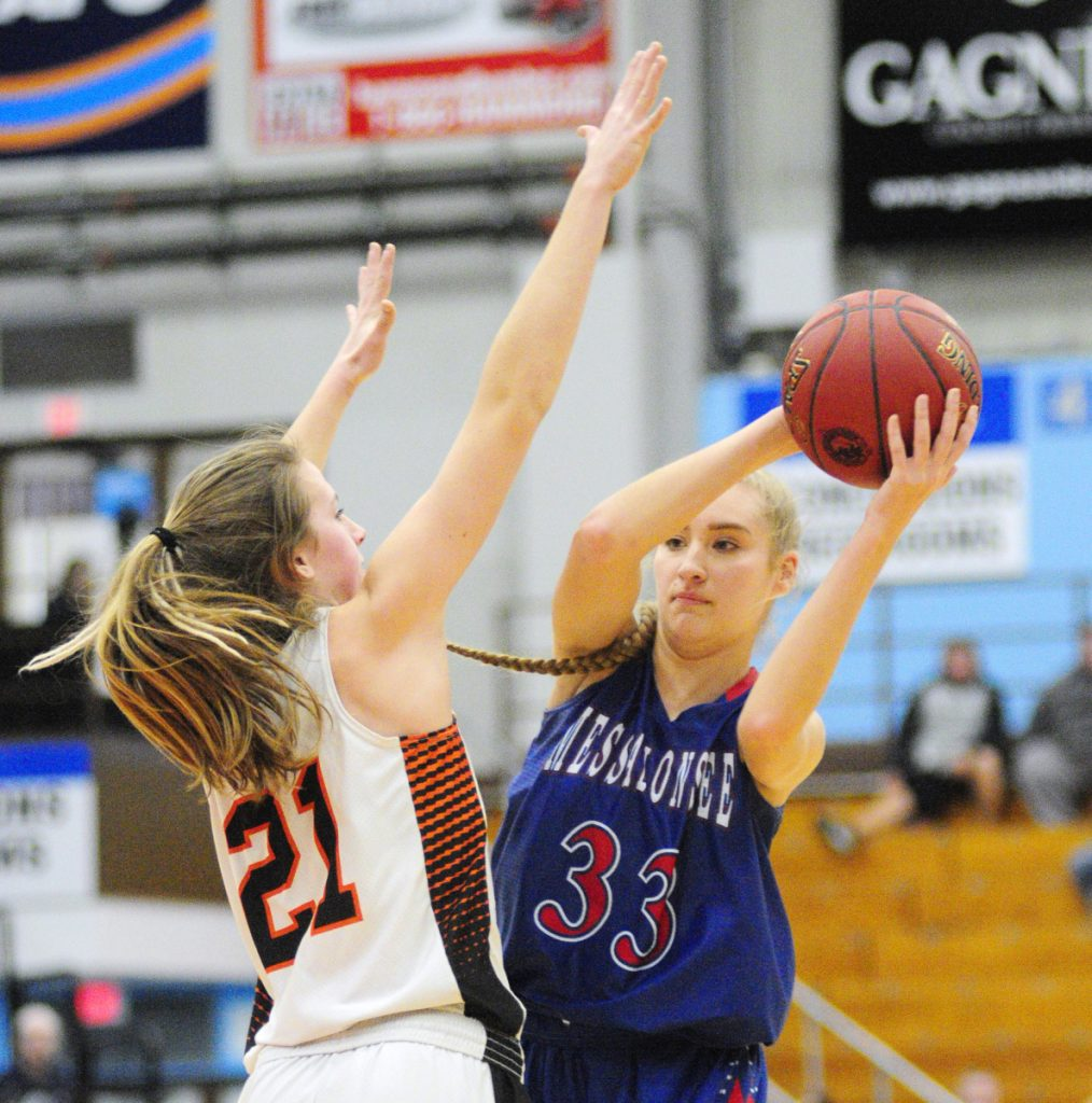 Skowhegan junior forward Annie Cook defends Messalonskee senior guard/forward Alyssa Turner during a Class A North semifinal game Wednesday at the Augusta Civic Center.