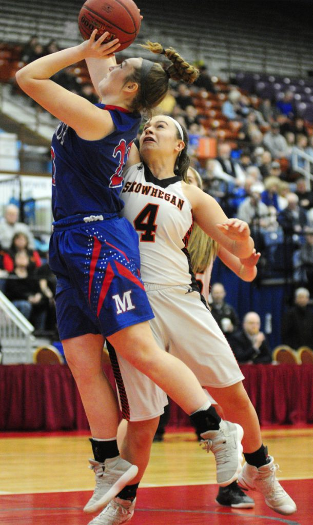 Messalonskee freshman Brooke Martin shoots as Skowhegan captain Lindsey Warren defends during a Class A North semifinal game Wednesday at the Augusta Civic Center.
