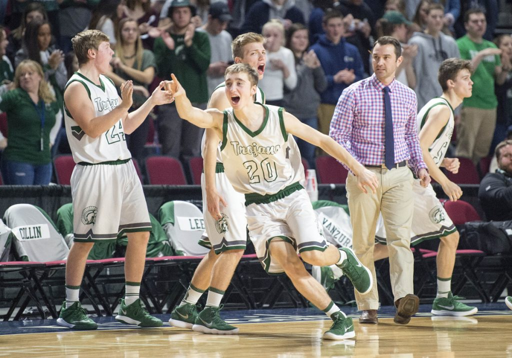 Mount Desert Island's Brett Duley celebrates with teammates after they took the lead over Presque Isle during a Class B North semifinal Wednesday at the Cross Insurance Center in Bangor.