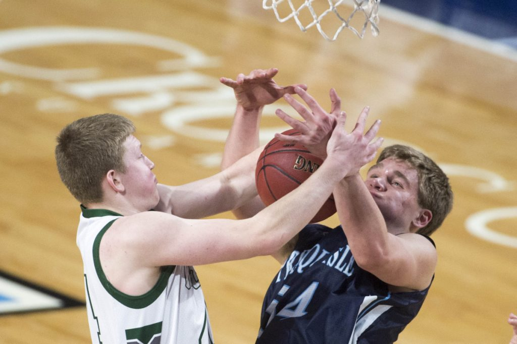 Mount Desert Island's Andrew Shea, left, battles for a rebound with Presque Isle's Trace Cyr during a Class B North semifinal Wednesday at the Cross Insurance Center in Bangor.
