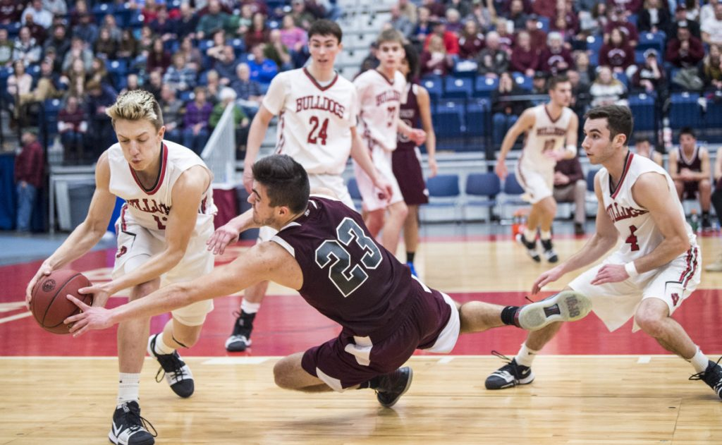 Richmond guard Zach Small (23) fouls Hall-Dale's Jett Boyer during a Class C South semifinal game Thursday at the Augusta Civic Center.