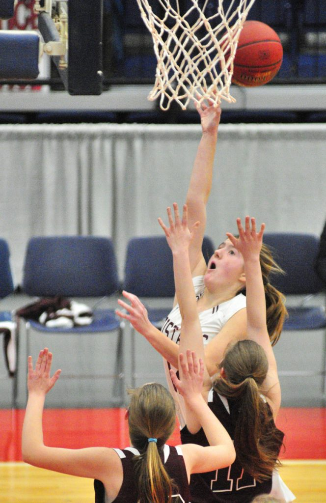 Monmouth senior Abbey Allen goes up for a rebound during a Class C South semifinal game against Richmond on Thursday at the Augusta Civic Center.
