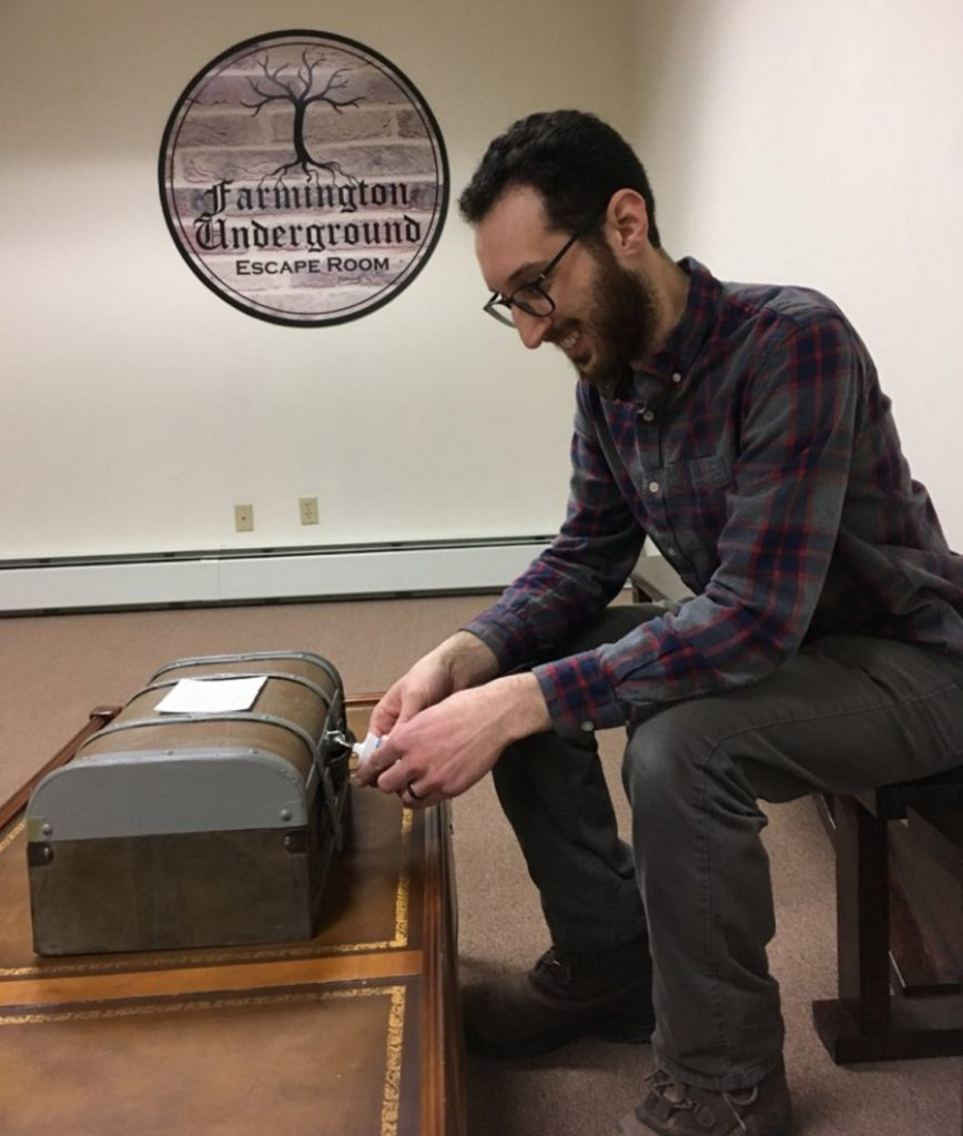 Joe Musumeci, owner and operator of Farmington Underground, demonstrates the introductory puzzle chest, the first challenge for participants at his escape room business at 109 Church St. in Farmington.