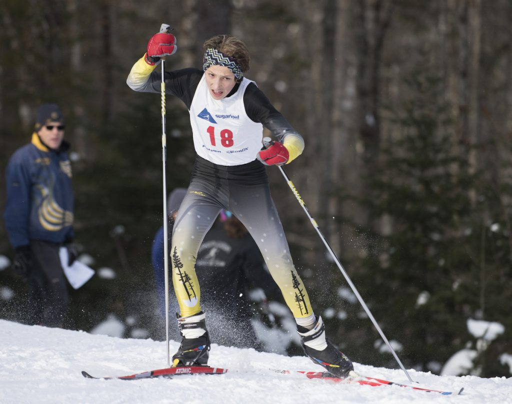 Maranacook's Carter McPhedran climbs a hill halfway through the first Nordic race of the season at the Sugarloaf Outdoor Center in mid-December.