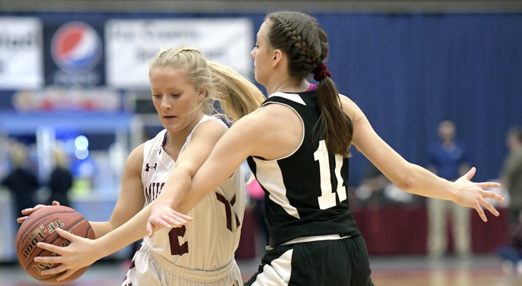 Monmouth's Audrey Fletcher dribbles around St. Dominic Academy's Rileigh Stebbins during a Class C South quarterfinal game Tuesday at the Augusta Civic Center.