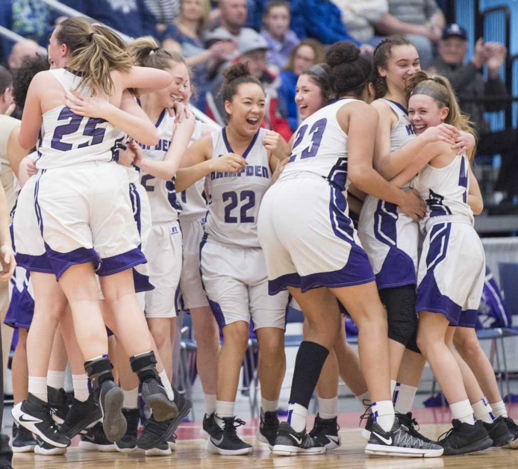 Hampden Academy celebrates its win over Messalonskee in the Class A North championship game Friday night at the Augusta Civic Center.