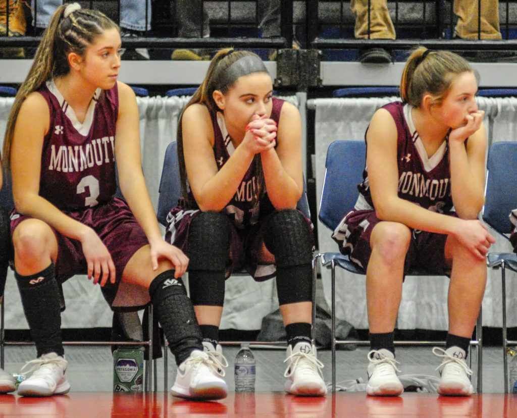 Members of the Monmouth Academy girls basketball team watch the action during the first half of the Class C South title game Saturday at the Augusta Civic Center.