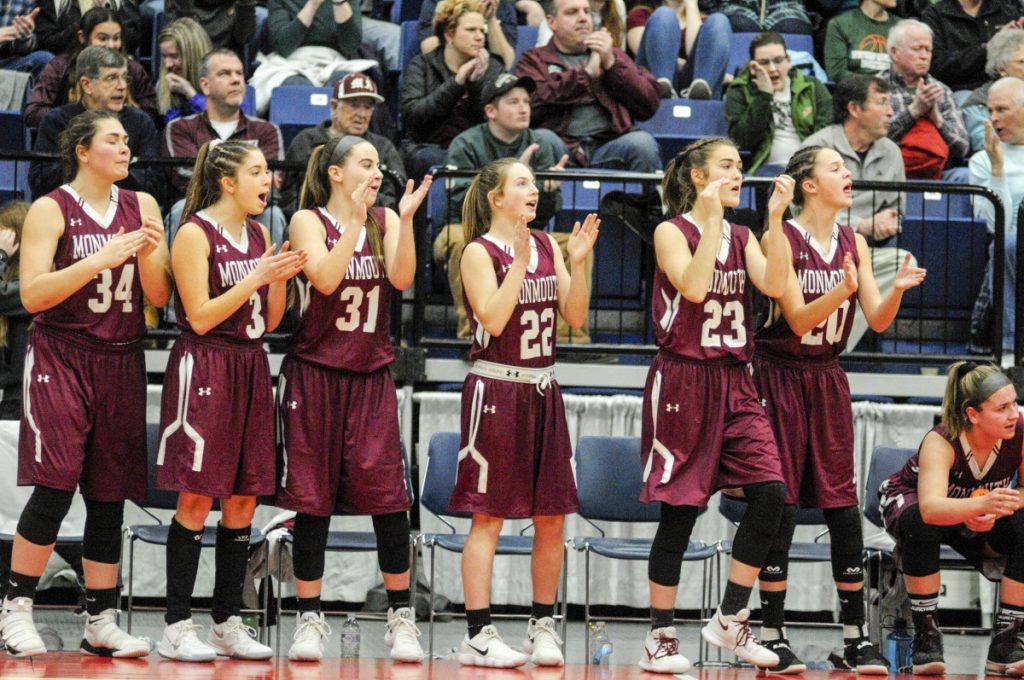 Members of the Monmouth Academy girls basketball team react during the Class C South title game Saturday at the Augusta Civic Center.