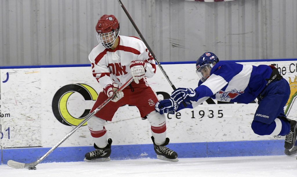Cony/Monmouth/Hall_Dale seniorr Avery Pomerleau, left, breaks away from Lisbon/Mt. Ararat/Morse's Cam Poisson during a Class A North game earlier this season in Hallowell.