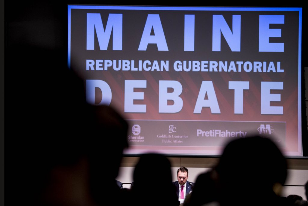 Garrett Mason, bottom center, one of five candidates participating in a debate gives his opening remarks at Ostrove Auditorium at the Diamond Building at Colby College in Waterville on Monday.