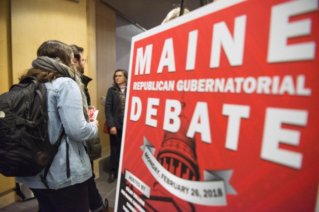 People enter the Ostrove Auditorium at the Diamond Building at Colby College in Waterville for the Republican gubernatorial debate on Monday.