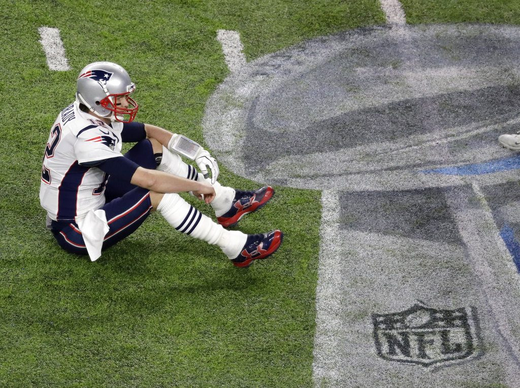 New England Patriots quarterback Tom Brady sits on the field after fumbling against  the Philadelphia Eagles during the second half of the NFL Super Bowl 52 ... 62e6b7394