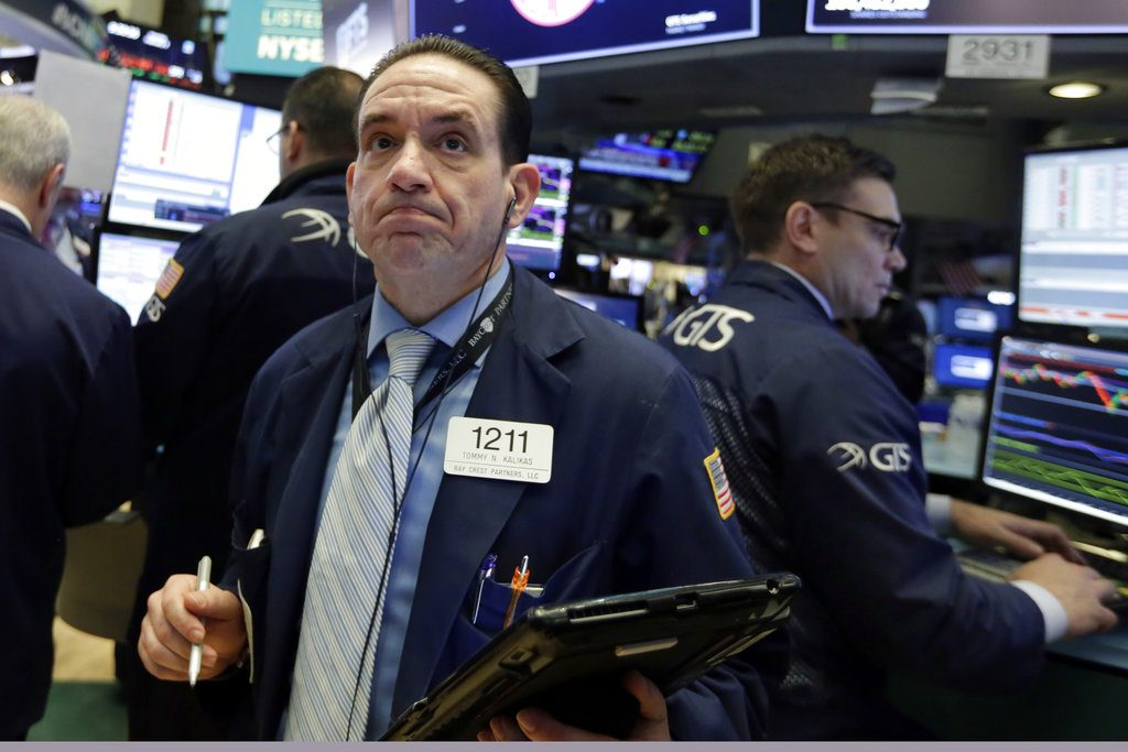 Trader Tommy Kalikas works on the floor of the New York Stock Exchange, Monday. Stock markets around the world took another pummeling Monday as investors continued to fret over rising U.S. bond yields.