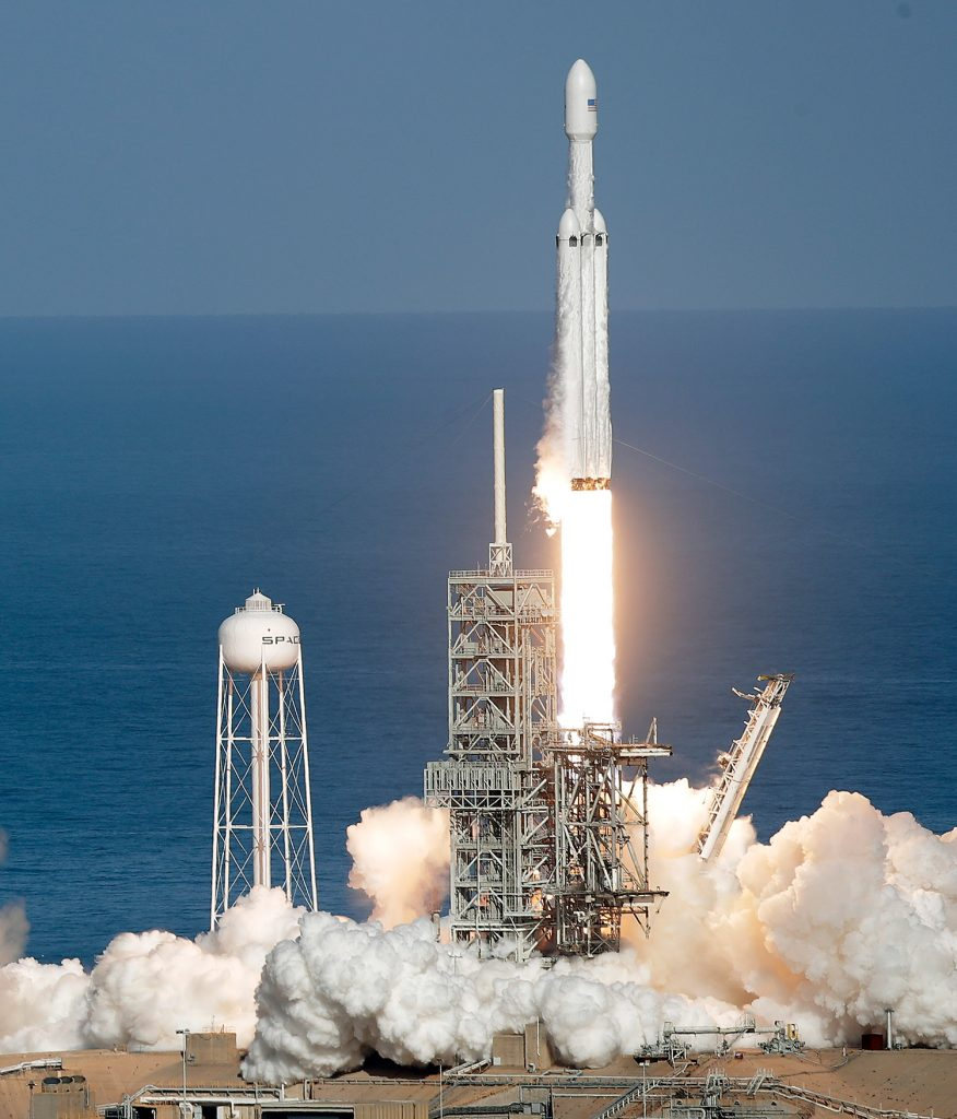 A Falcon 9 SpaceX Heavy rocket lifts off from pad 39A at the Kennedy Space Center in Cape Canaveral, Florida, on Tuesday. The Falcon Heavy has three first-stage boosters, strapped together with 27 engines in all.