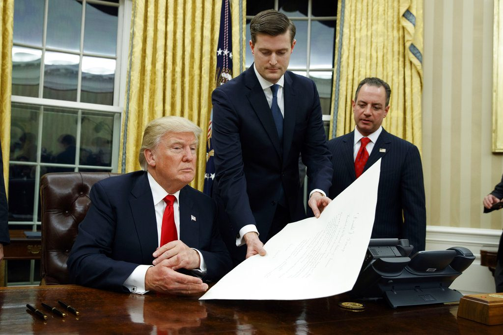 White House Staff Secretary Rob Porter, center, President Donald Trump and Chief of Staff Reince Priebus in January 2017.