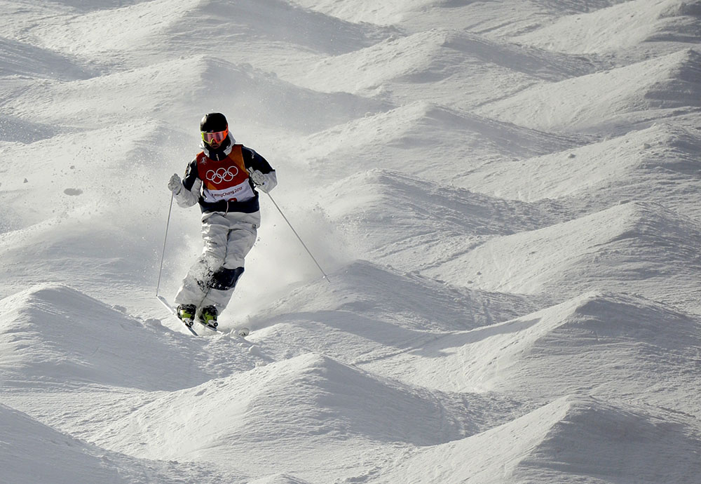 TroyMurphy of Bethel takes on the bumps Friday in the men's moguls qualifying round in Pyeongchang, South Korea. Murphy finished fourth to advance to the finals.