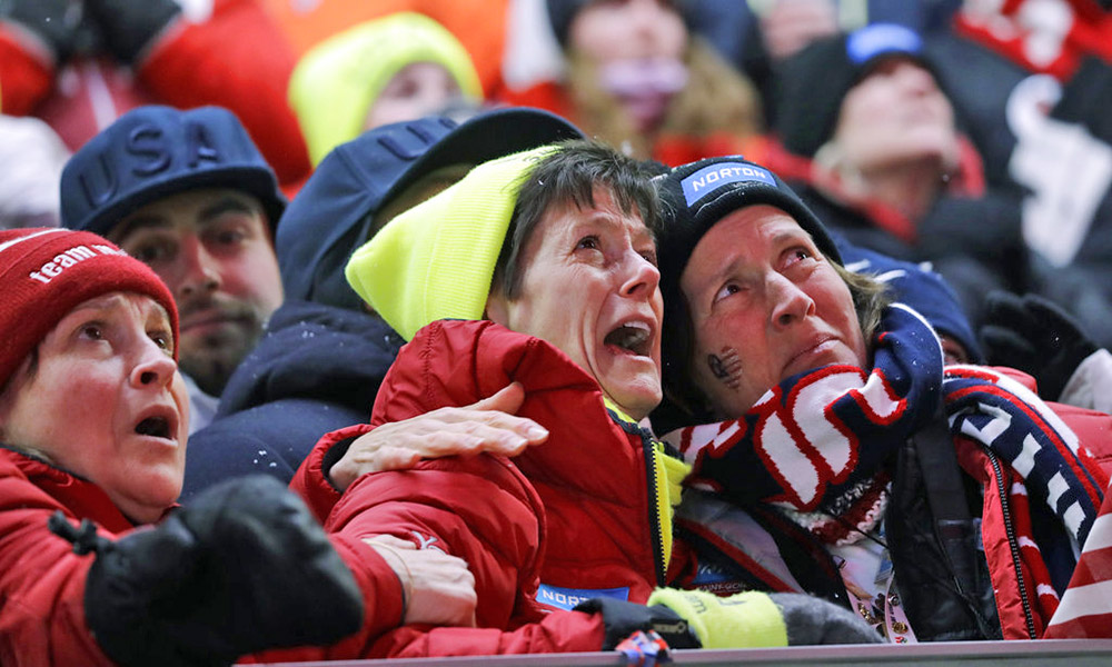 Sue Sweeney, center, the mother of Emily Sweeney of the United States, cries out as her daughter crashes on the final run during the women's luge final Tuesday.