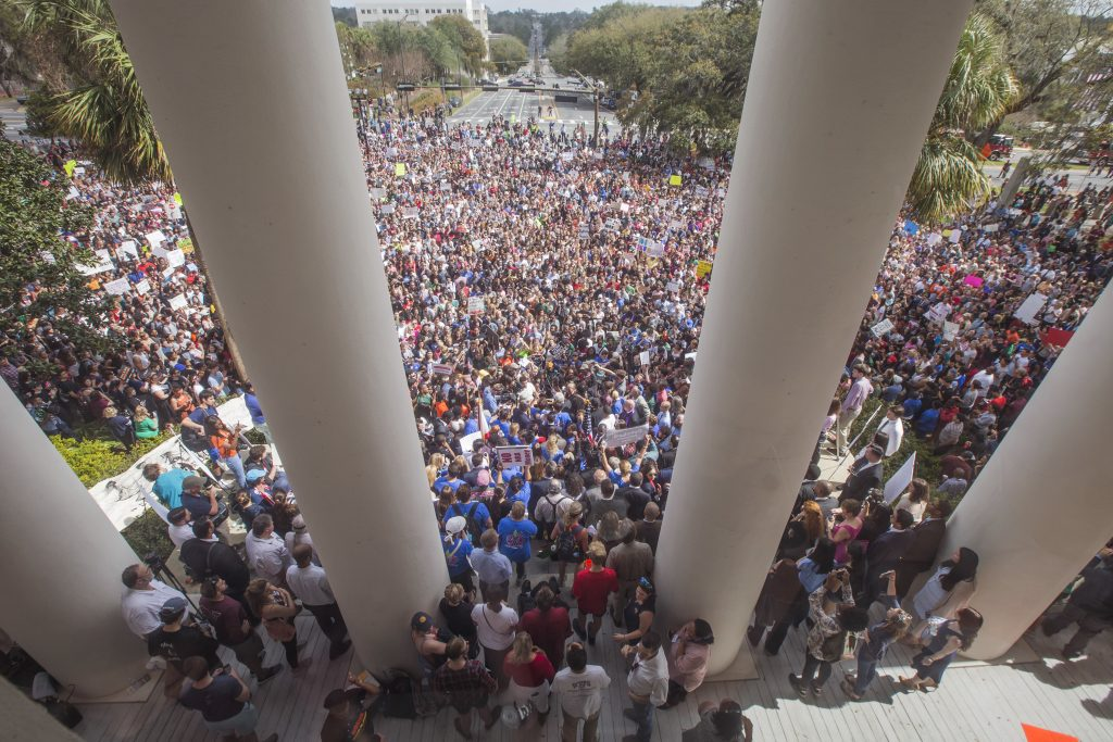 Protesters rally against gun violence on the steps of the old Florida Capitol in Tallahassee, Fla., Feb 21, 2018. Students at schools across Broward and Miami-Dade counties in South Florida planned short walkouts that day, the one week anniversary of the deadly shooting at Marjory Stoneman Douglas High School.
