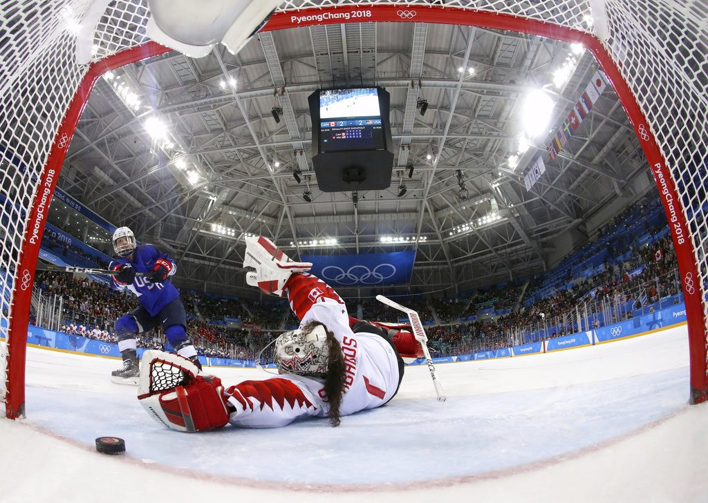 Jocelyne Lamoureux-Davidson of the United States scores the game- winning goal against  Shannon Szabados  of Canada in the overtime shootout Thursday.