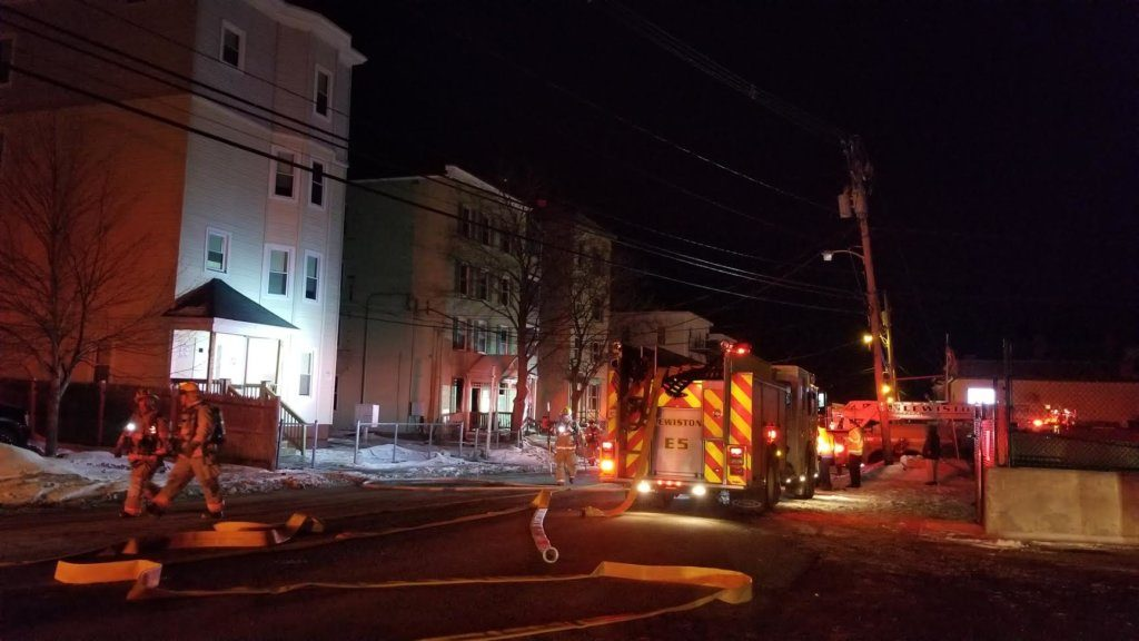 Lewiston firefighters work to douse flames at 242 Park St. early Sunday.