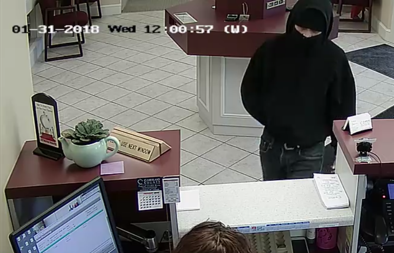 This image from a security camera shows the person who robbed a credit union in Falmouth on Wednesday. Police are asking for the public's health in identifying the person.